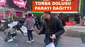 Torbayla getirdiği paraları meydanda dağıttı