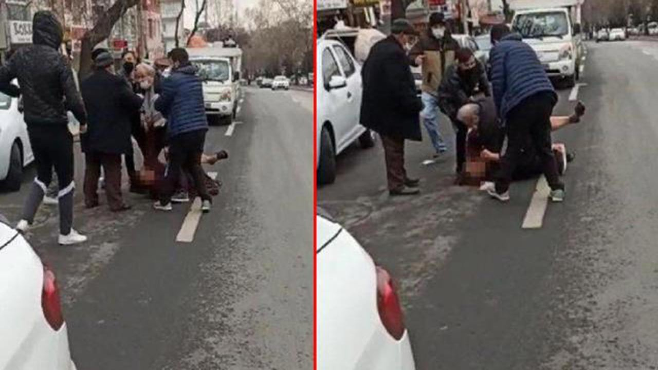 Eşini sokak ortasında darp etti