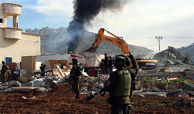 İsrail Filistinlilere ait 11 binayı yıktı