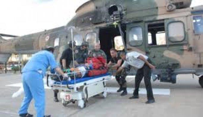 Muğla'da kayalıklara düşen paraşütçü kurtarıldı