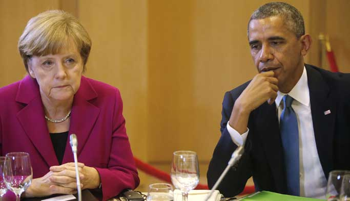 Obama ve Merkel, Putin ile Esad'ı kınadı