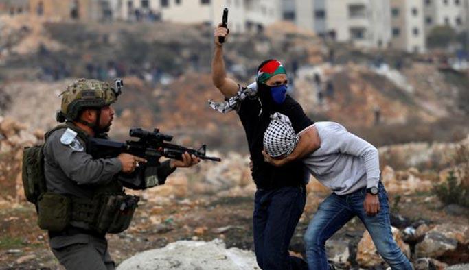 Filistin'deki gösterilerde 'İsrail ajanları' kol geziyor