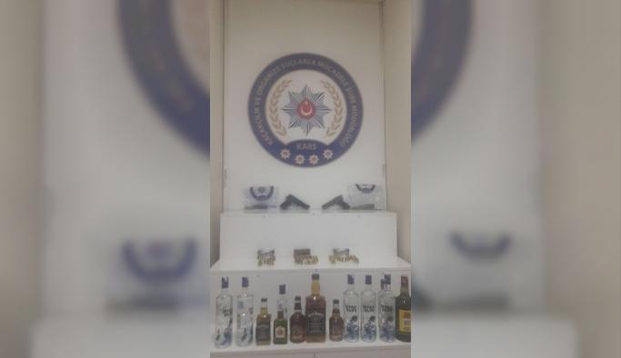 Kars'ta kaçak içki ve silah ele geçirildi