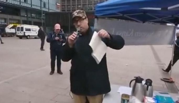 Finlandiya'da parti lideri Kur'an-ı Kerim'i yırtıp yere attı